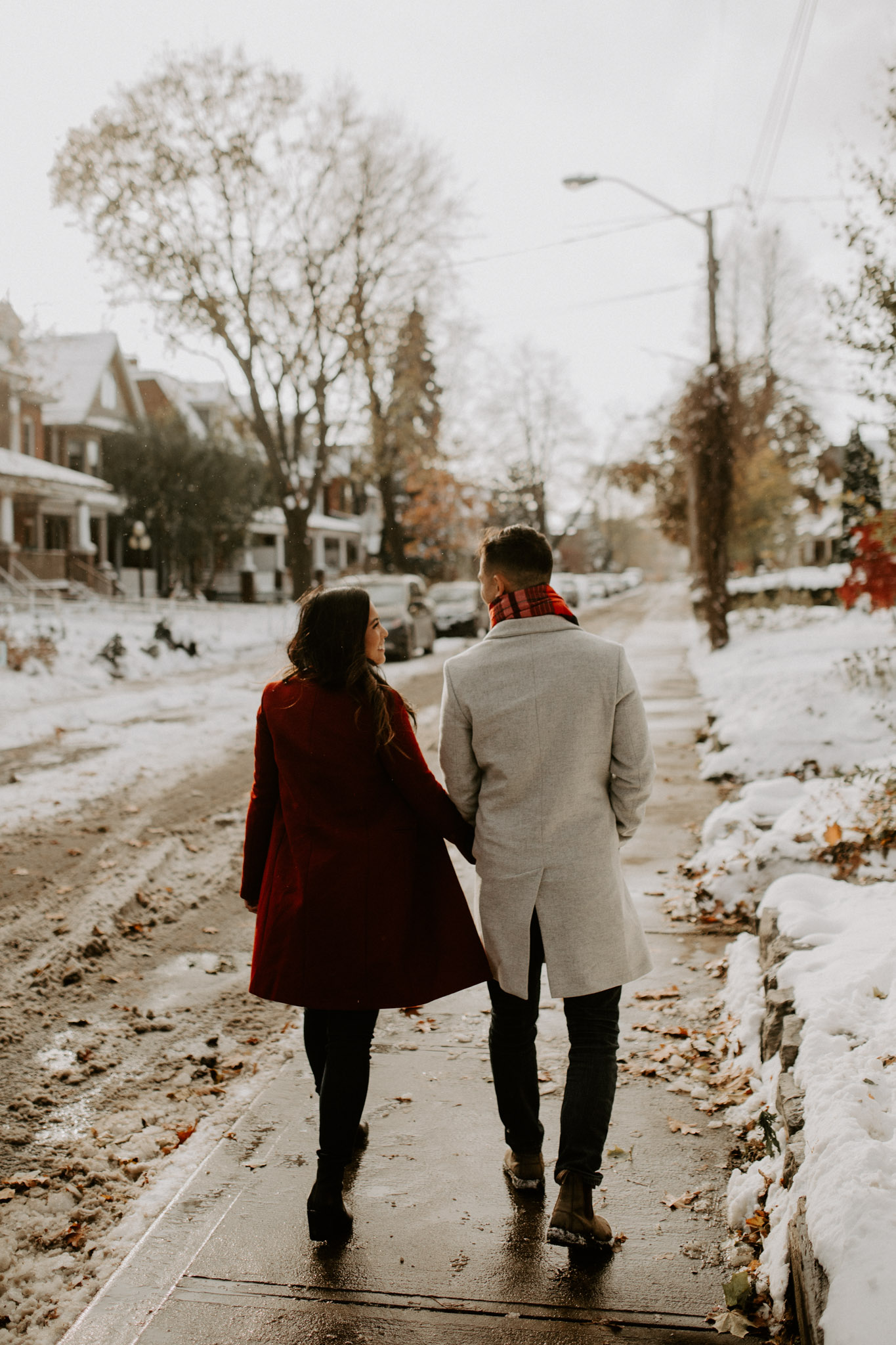Winter Engagement in Toronto - couple walk down snowy street