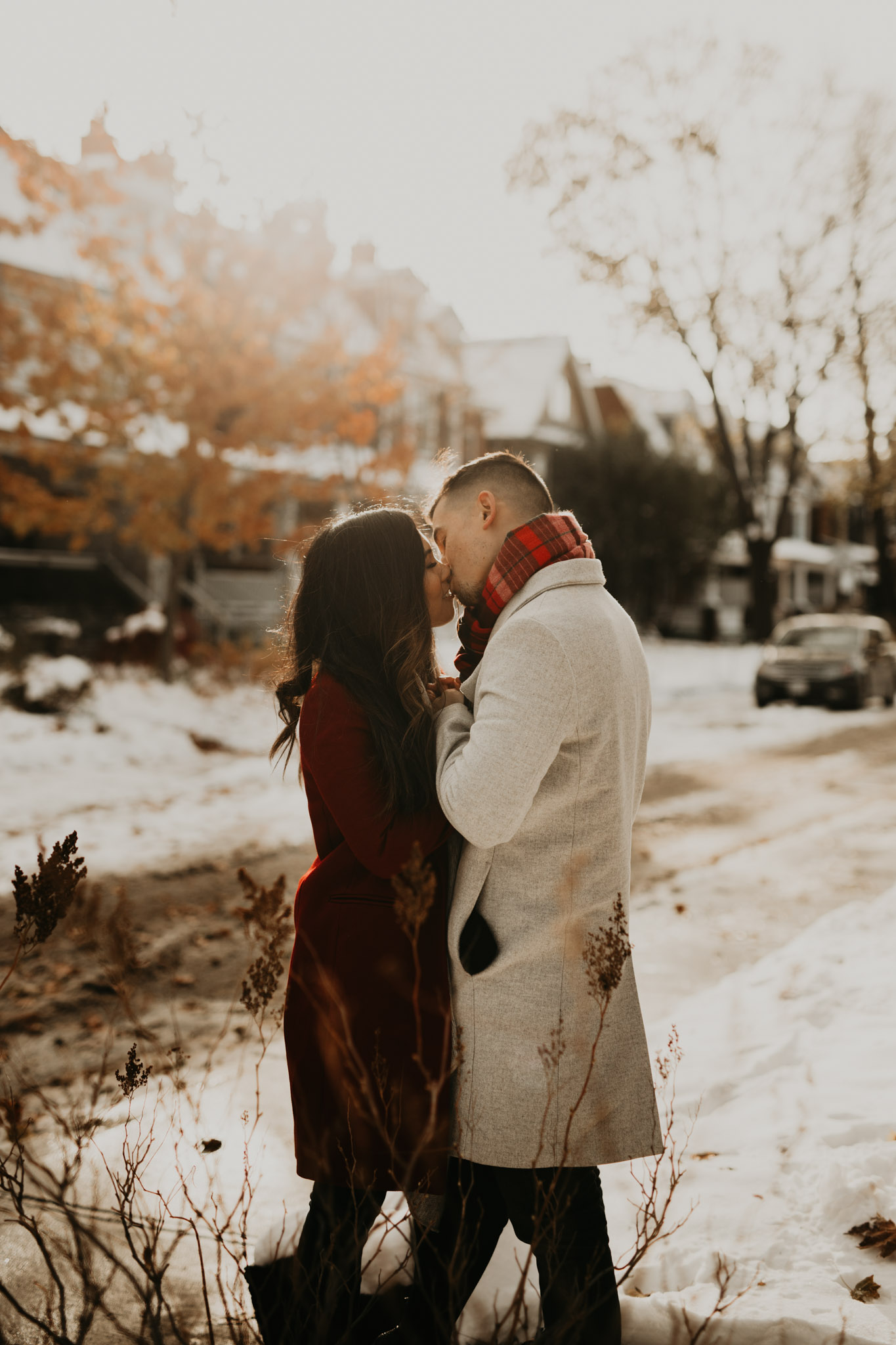 Winter Engagement in Toronto - couple kiss in the snow