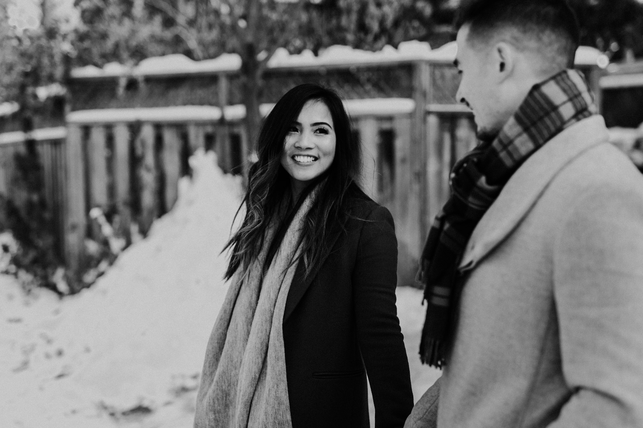 Winter Engagement in Toronto - woman in coat smiles and fiance