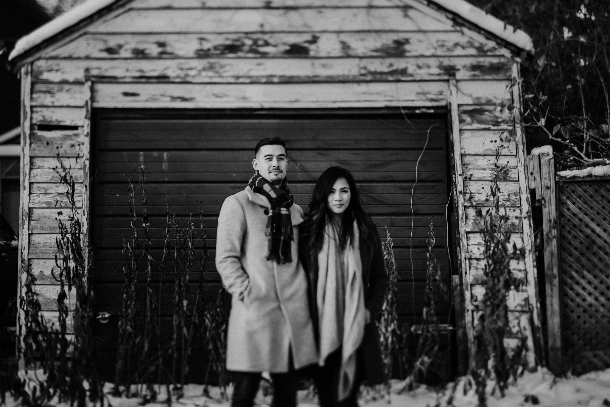 Winter Engagement in Toronto - couples portrait in front of garage
