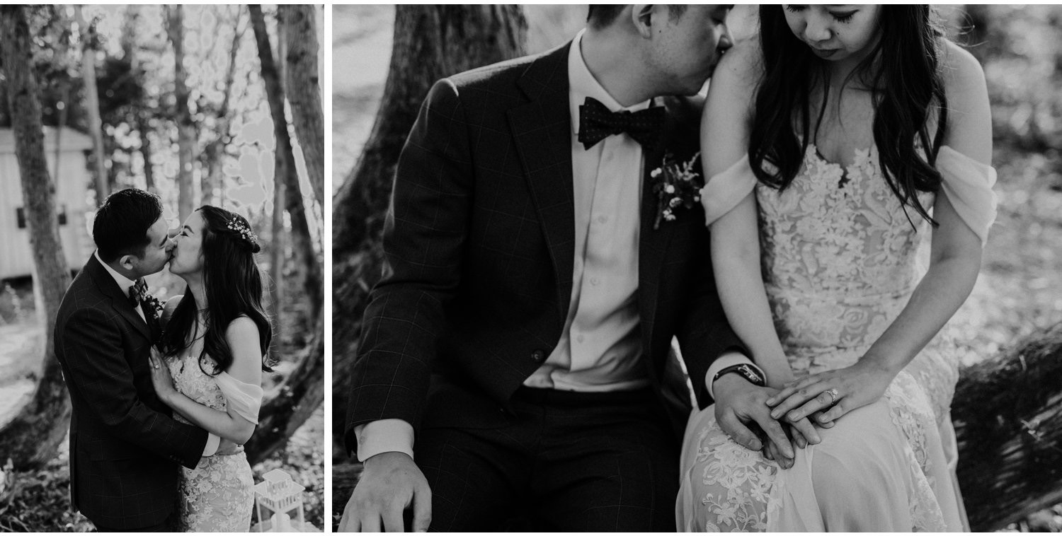 Serenity Cottage Wedding - black and white portraits of bride and groom kissing in the forest