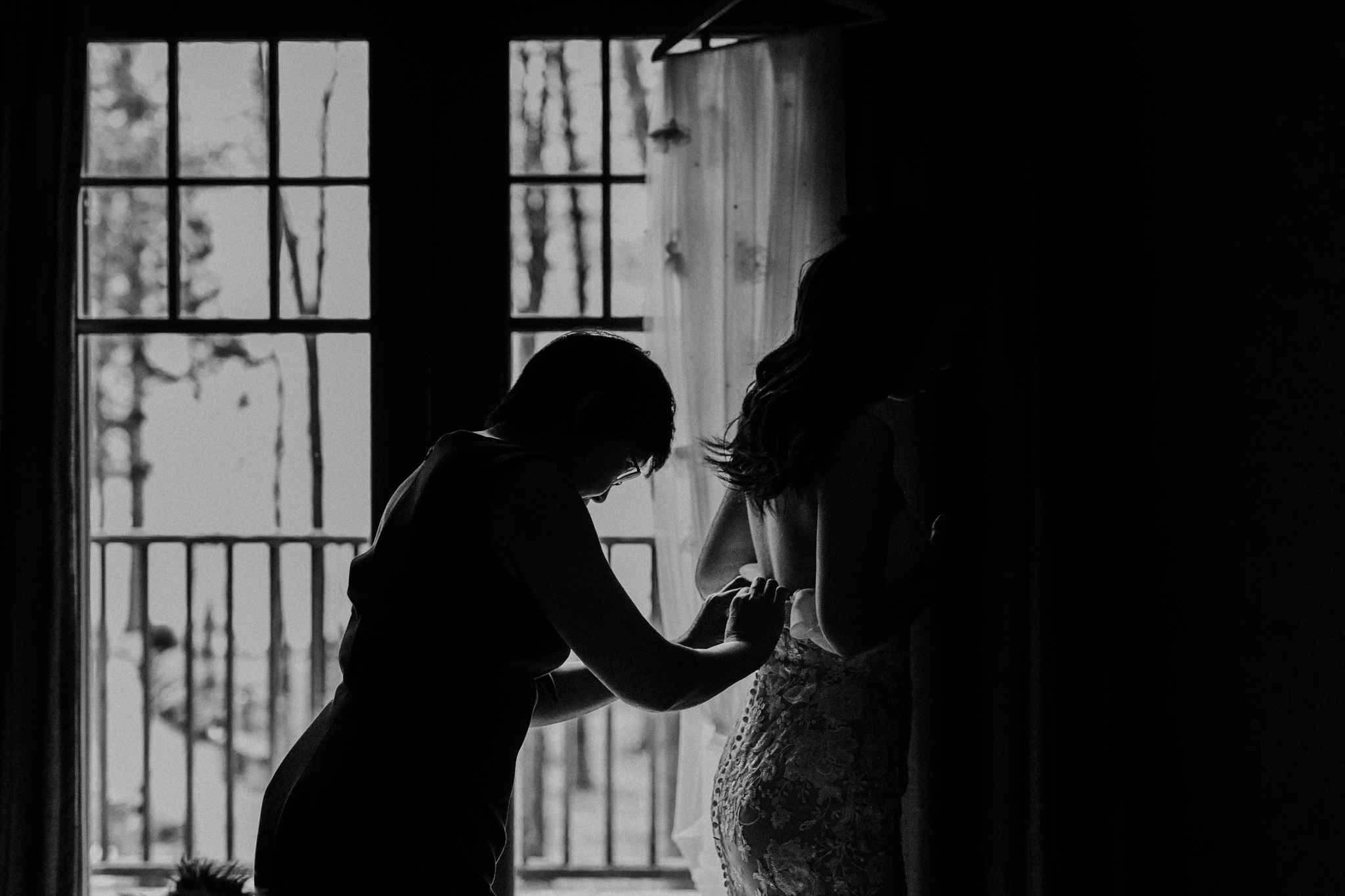 Serenity Cottage Wedding - silhouette of bride getting dressed