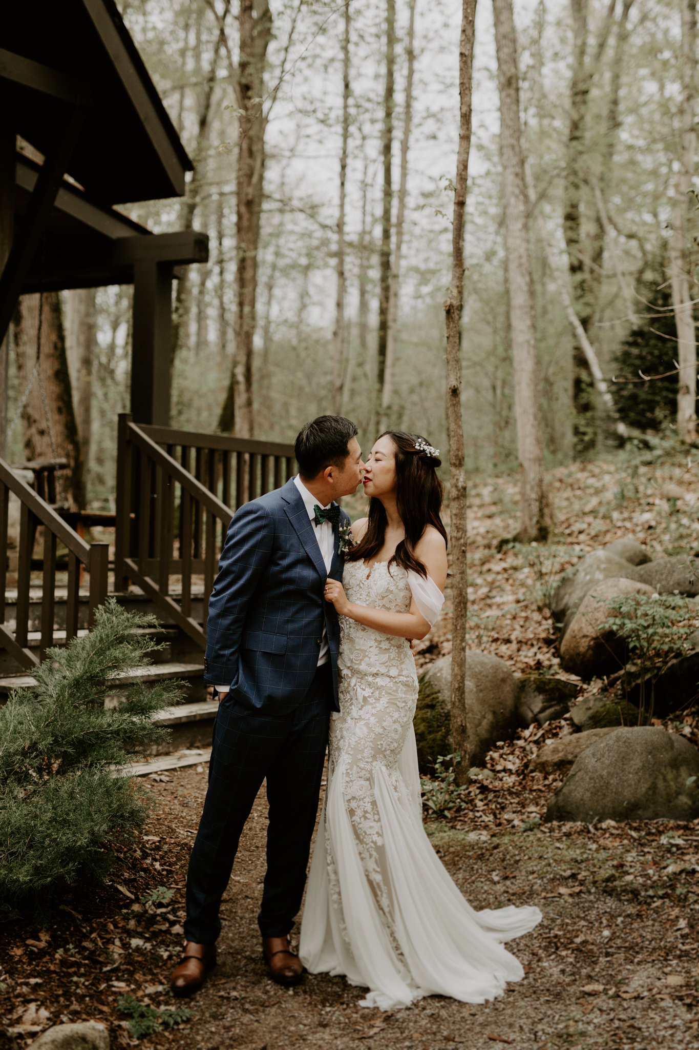 Serenity Cottage Wedding - bride and groom kiss in front of cottage