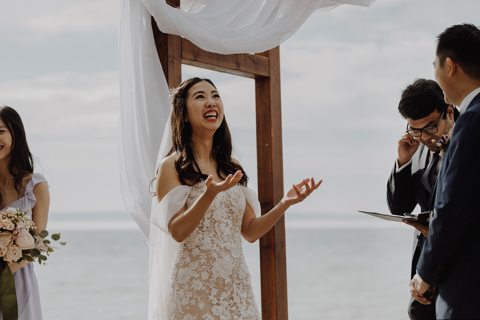 Serenity Cottage Wedding - bride laughing at lakeside alter