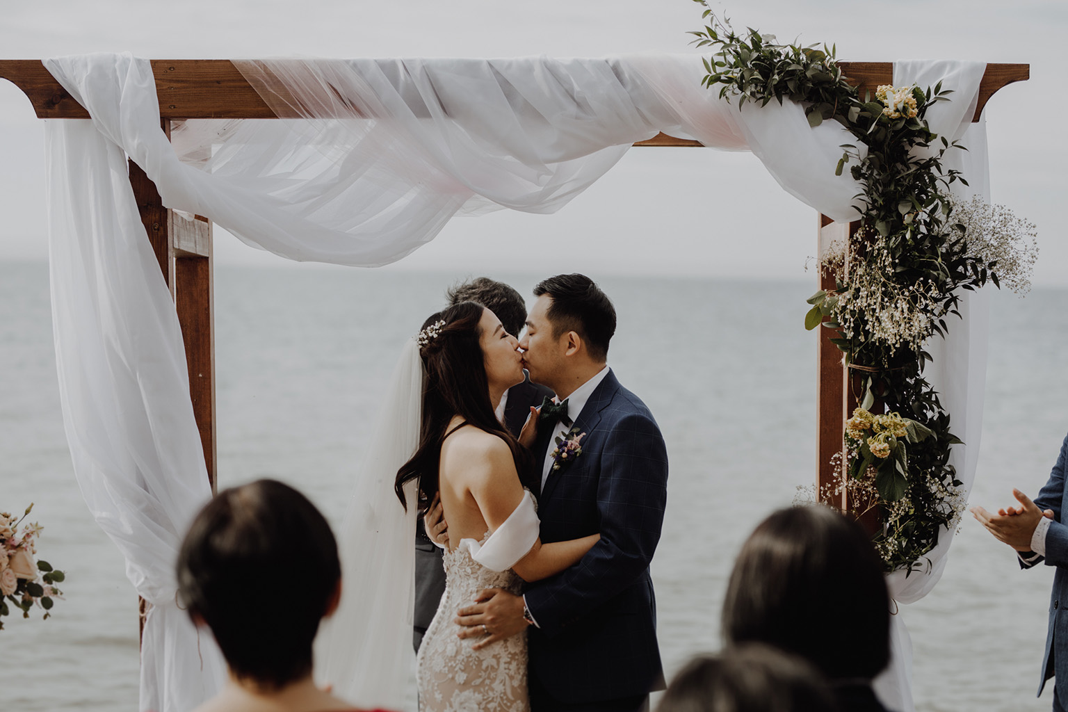 Serenity Cottage Wedding - bride and groom kiss at lakeside alter