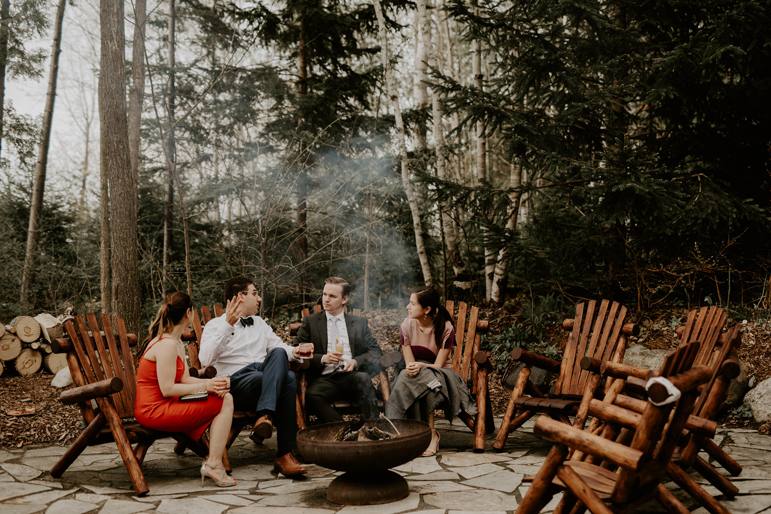 Serenity Cottage Wedding - guests lounging around fire pit