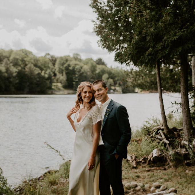 bride and groom posing at Lake of Bays wedding in Muskoka